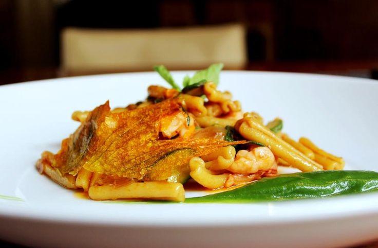 Casarecce pasta with zucchini, prawns and zucchini flowers