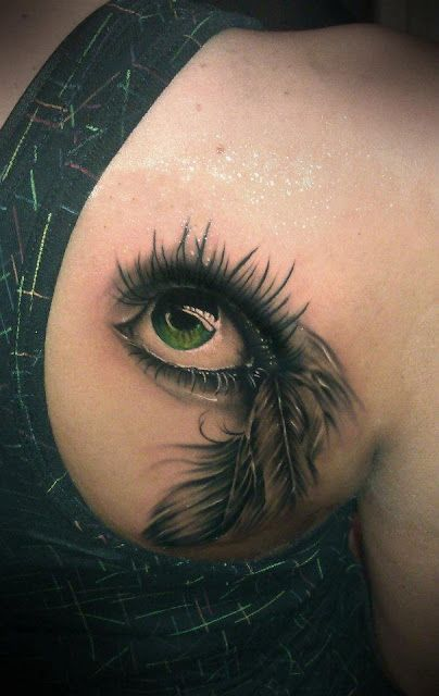 Realistic 3D green eye tattoo on back. A little frightening, but pretty awesome, too.