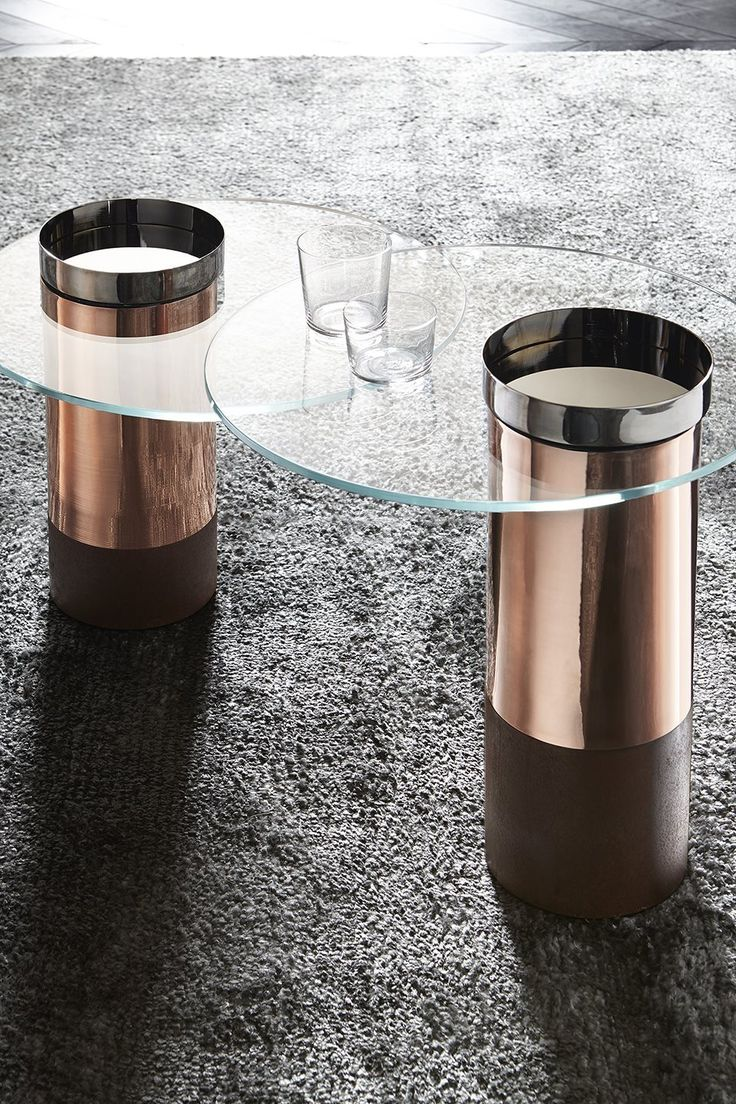 Haumea, coffee table in transparent extra light tempered glass. Rust lacquered wooden base. Design Massimo Castagna.