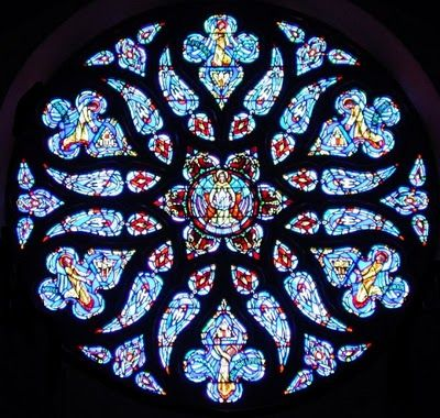 Rose window- a general term applied to round decorative windows, with a design that rewembles the petals of a rose.  Rose windows are characteristic of Gothic architecture.