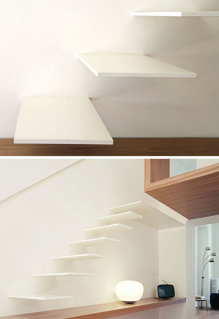 These minimalist white floating stairs include a wooden step, which extends to become a desk.