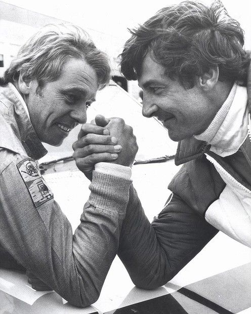 Dick Johnson takes on Peter Brock in an arm wrestle.