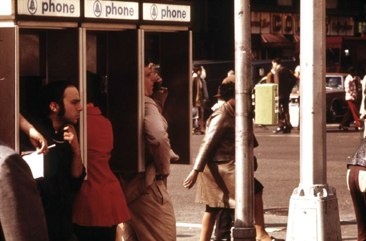 Public pay phone stalls in use at Broadway and 34th Street, in May of 1973. The first handheld mobile phone call in history was made one month prior to this photo, in midtown Manhattan, in April 1973, when Martin Cooper, a Motorola researcher made a call to his chief competitor Dr. Joel S. Engel, head of Bell Labs. (Erik Calonius/NARA)