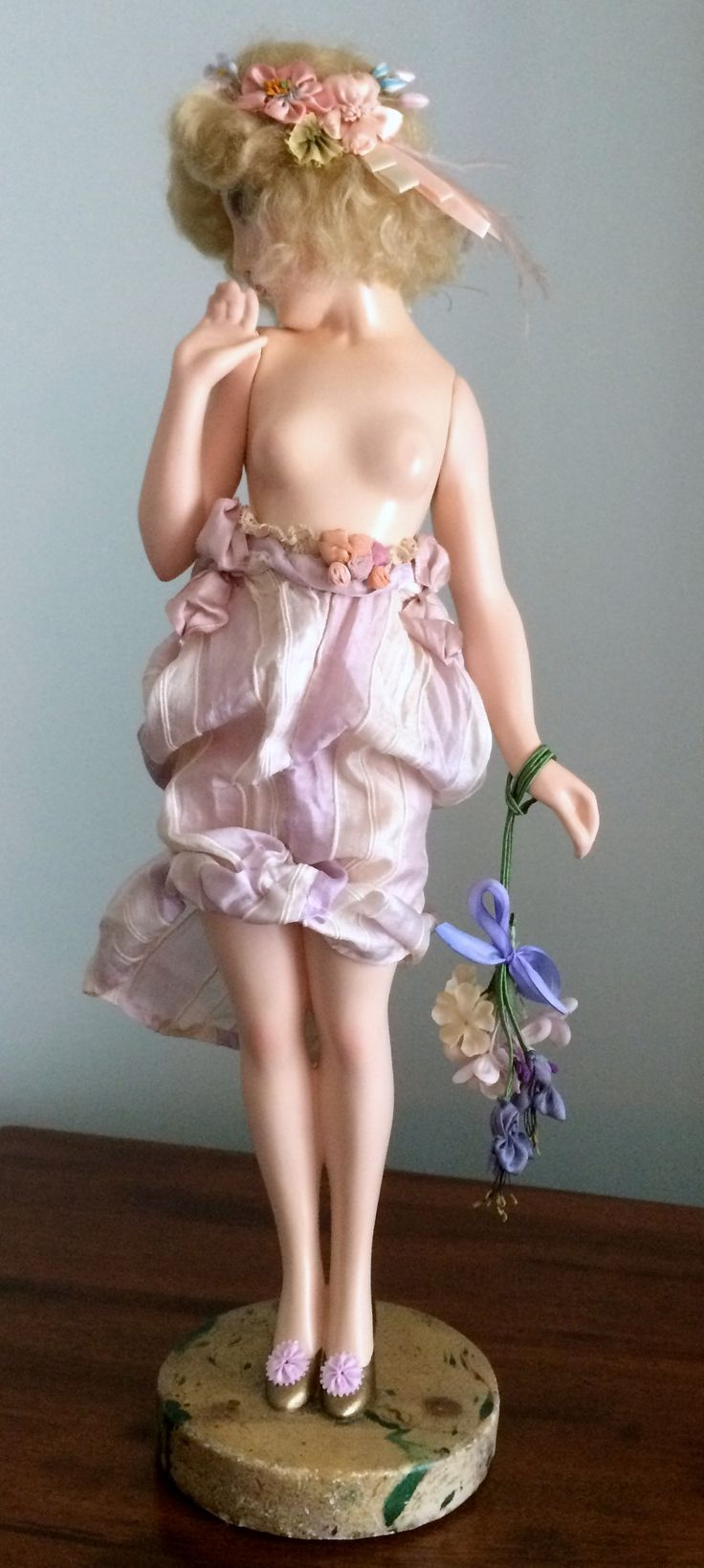 """Painted plaster doll, titled, """"Naiade,"""" 15 ½ inches tall, by Maurice Milliere."""