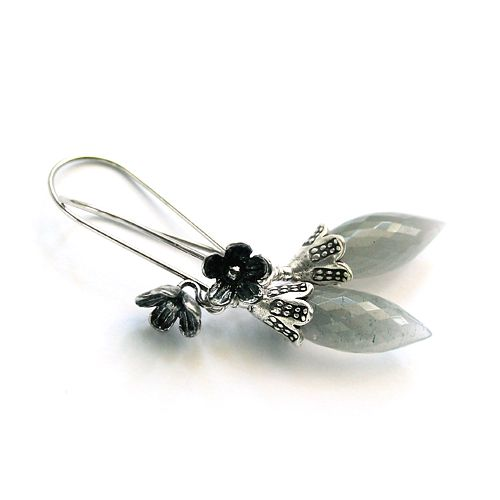 Moon stone and silver flowers.