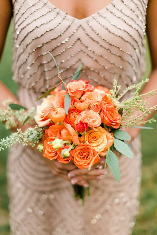Love this orange floral arrangement for a bridesmaid bouquet at your spring or summer wedding.