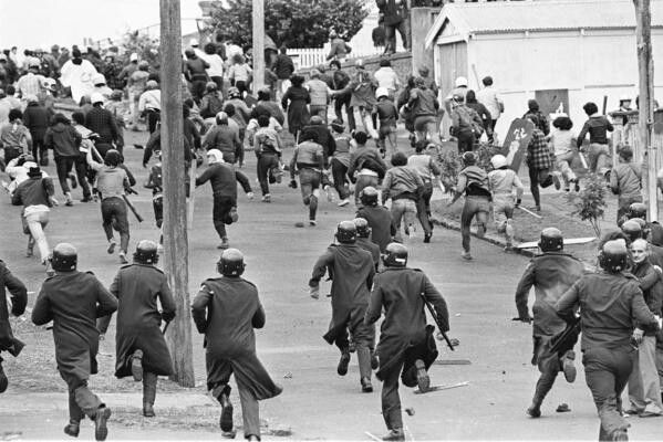 1981 Springbok Tour. New Zealand Police chase protesters up Onslow Rd outside Eden Park, Auckland. Image John Selkirk