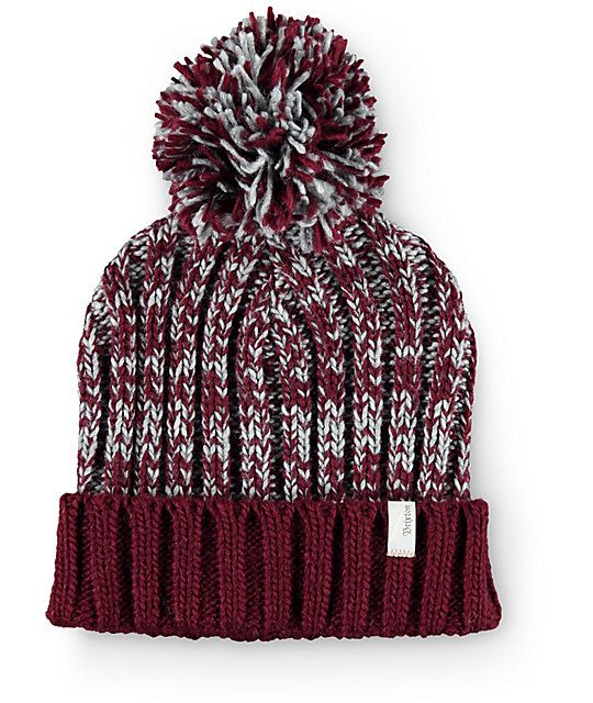 This cuffed style beanie is made with a grey and burgundy mixed marled knit construction and a large pom at the top.