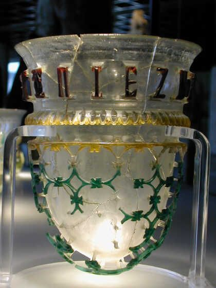 A beautiful Diatret glass, cut out of a single piece of glas of differently colored layers. Römisch Germanisches Museum, Köln, Germany.  Another -complete- example can be found in the Antikensammlung München, Germany