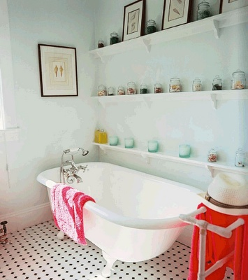 This type of display shelving could work in the downstairs tub bathroom.
