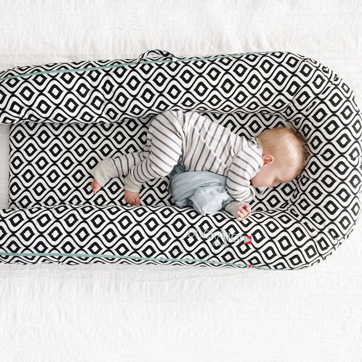 DockATot portable baby bed has helped a ton with travel! We've traveled a lot since we've had Houston and the Dock a Tot has been a big lifesaver as far as sleep goes! Our other kids have struggled the first night or two when we travel because, of course they're used to sleeping in their crib rather then a pack n' play. Visit dockatot.com to shop for this must have new mom essential.