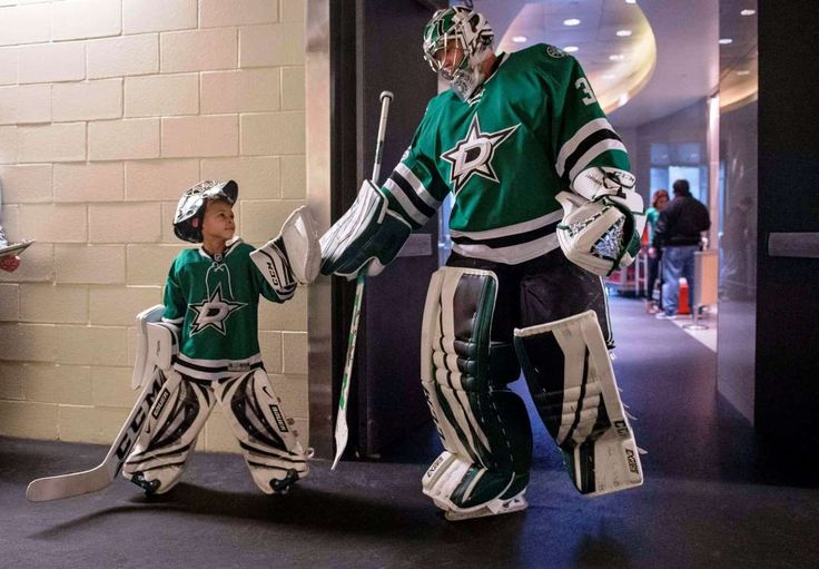 Little man, big fan:    Dallas Stars fan Zavier Green of Grand Prairie, Texas, greets goalie Kari Lehtonen before the game against the New York Islanders at the  American Airlines Center in Dallas. March 2.