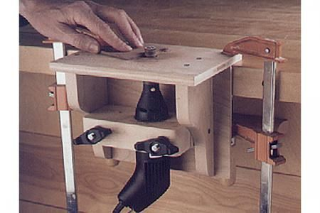 Make a mini router table for your high-speed rotary tool.