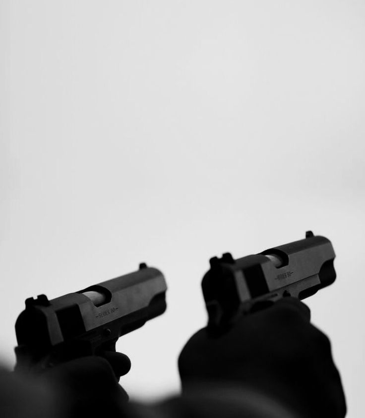 """(Closed) His hand shot back a bit as he pressed the trigger, watching the bullet hit bullseye. He never missed a shot. Never. He couldn't. Since the first day he picked up a gun, which was when he was nine, he never missed the target. But on this particular day, his target was a picture posted to the side of a brick building. From the sounds of gunfire, he didn't hear the footsteps. """"What are you doing?!"""" Someone said. Alarmed, he spun around, pointing both guns at the newcomer's head."""