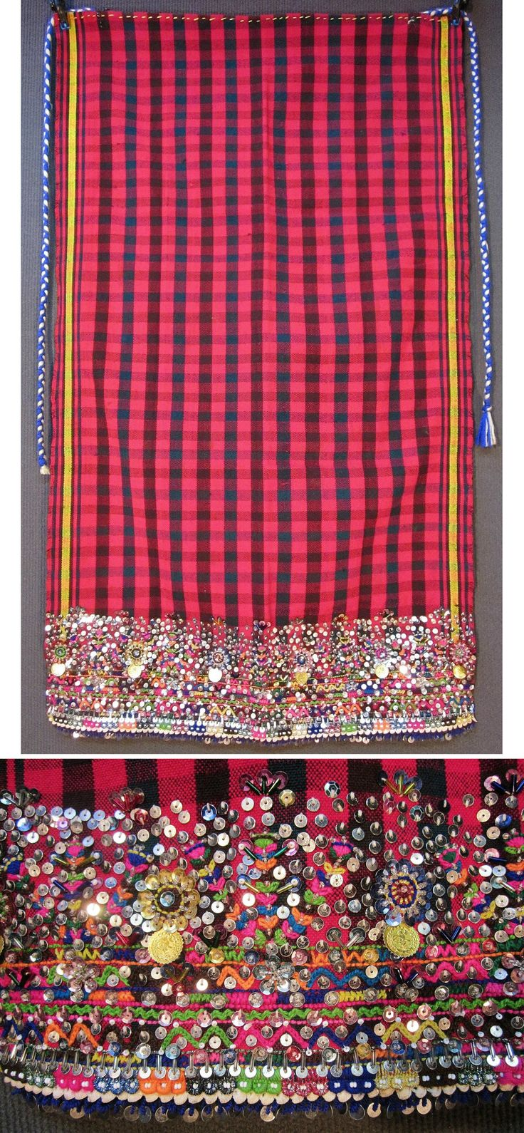 Traditional woollen 'önlük' (apron) from the Pomak villages in the Biga district (Çanakkale province).  Locally called 'önleç'.  Part of a bridal/festive costume, 1950-1975.  Adorned with cotton embroideries, small glass beads, imitation Ottoman coins, multicoloured pom-poms and lots of sequins (both metal and mica); the lower border edged with cotton crochet lace.  (Inv.nr. önL103 - Kavak Costume Collection - Antwerpen/Belgium).