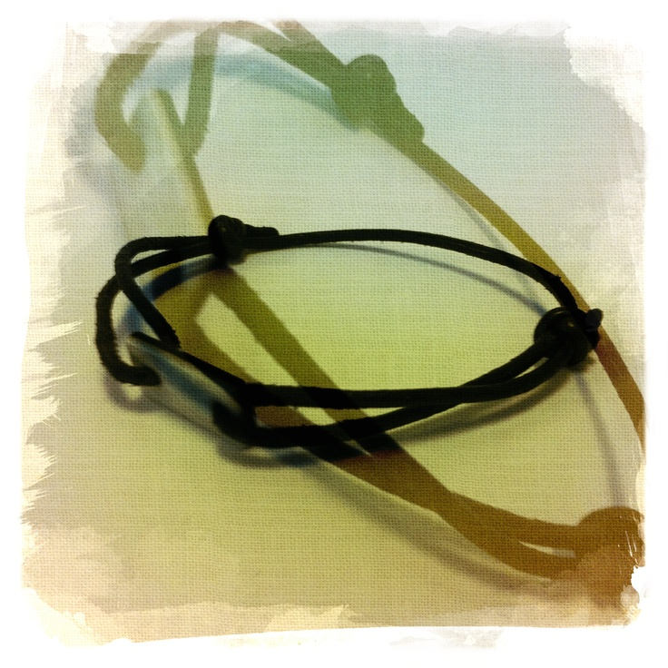 A bracelet I have made out of leather and ivory and ebony pieces from a old piano.