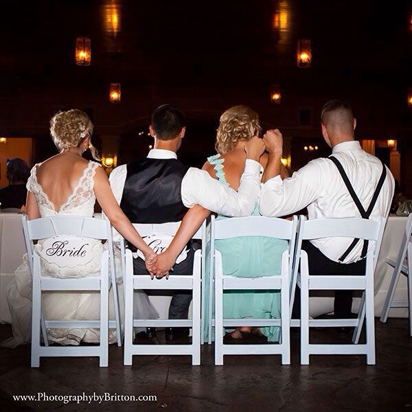Maid of honor and groomsman with couple