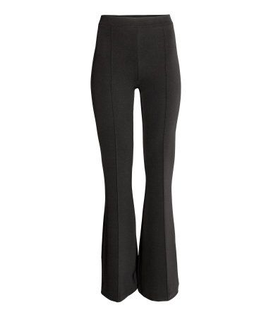 Black. Trousers in sturdy jersey with an elasticated waist, fake back pockets…
