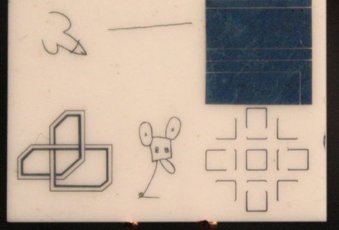 doodles by Warhol, Oldenburg & others on a ceramic wafer left on the moon by Apollo 12 in 1969