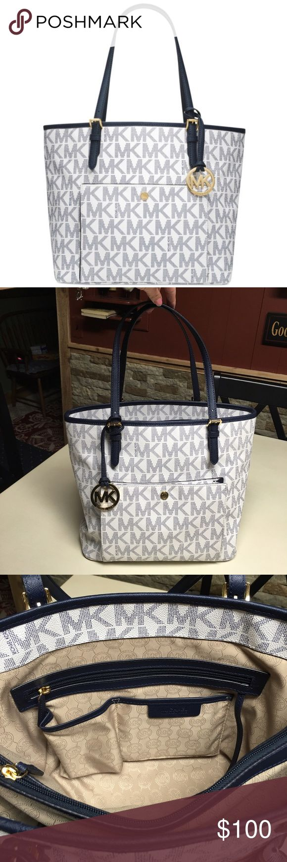 Michael Kors Jet Set Travel Tote New without tags! Michael Kors Jet Set Travel Tote in navy and white! There's a card pocket in the front of the person! No defects, odor, or stains! **AUTHENTIC** Michael Kors Bags Totes