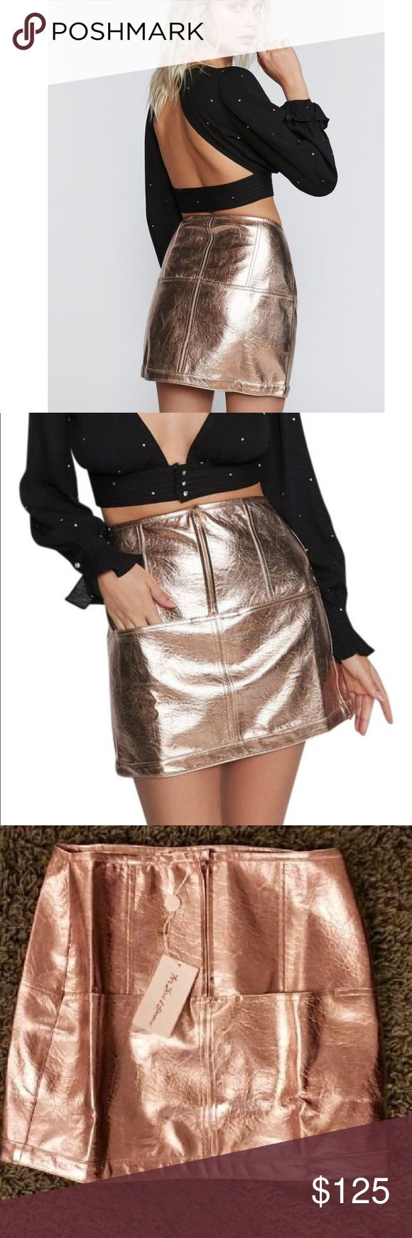 For Love & Lemons Luna Metallic Skirt NWT Luna Metallic Skirt designed on gold metallic leather with front metal zipper and inset front pocket seams (size down one size for a high waisted look). With its split needle top stitching and slight a-line flared hem, no detail is left behind. Dress up with your best-friend to channel your inner '90s self with the Cosmic Lace Bodysuit and the Luna Metallic Dress.  Exposed front metal zipper Inset pocket seams Slight A-line flared hem Lined For Love…