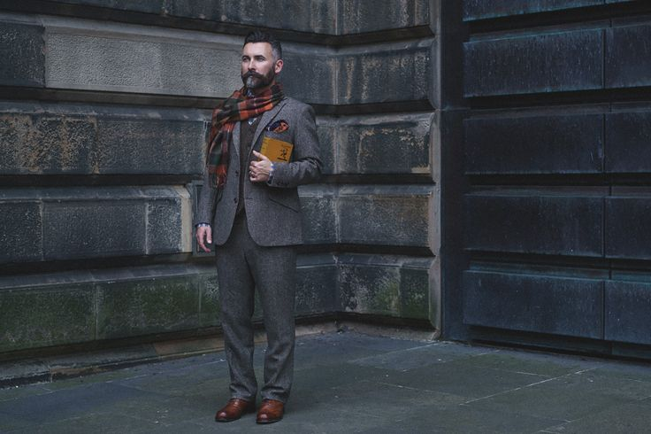 The Modern Gentleman - Tom wears the Edward suit in brown twill, Ray shirt in navy tartan, lambswool tartan scarf and orange silk pocket square.