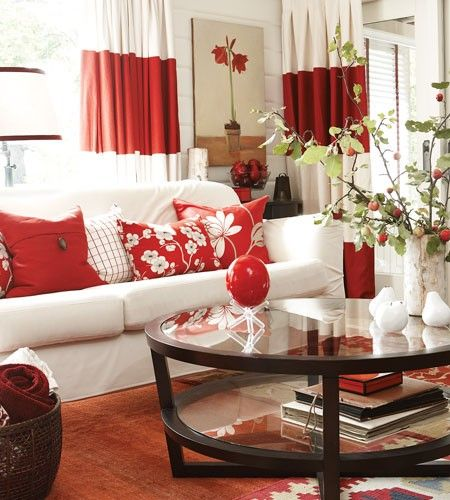 red in drapes is too much (agree with the person I re-pinned this from) -- but love the red pillows on the white couch.  Basement!