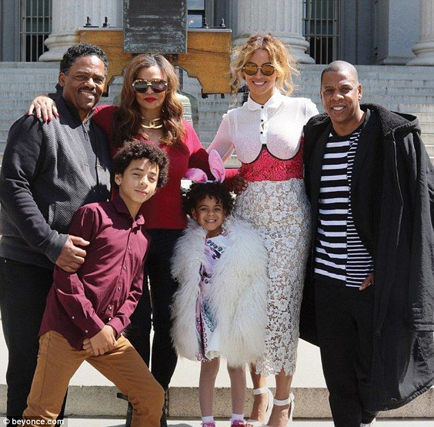 The one I love: The Love On Top (second from right) posed with (from left) her stepfather Richard Lawson, her nephew Daniel Julez Smith, Jr, her mother Tina Lawson, her daughter and Jay-Z