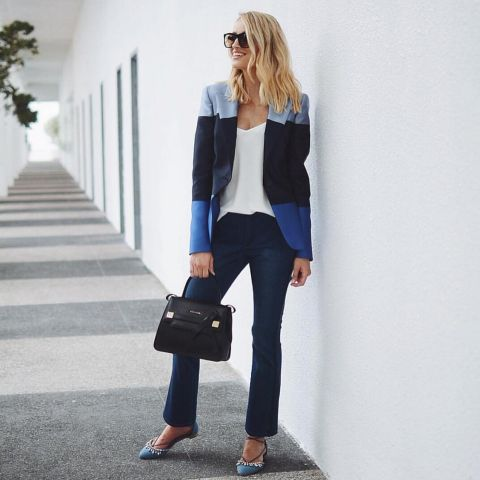 Casual Fridays are fit for jeans, but it's time you stepped up your denim digs. Half-tuck a simple white top, then add a printed blazer and festive flats for a look that feels both playful and polished. @littleblondebook wearing ESCADA Bozica Blazer, $1,450, us.escada.com