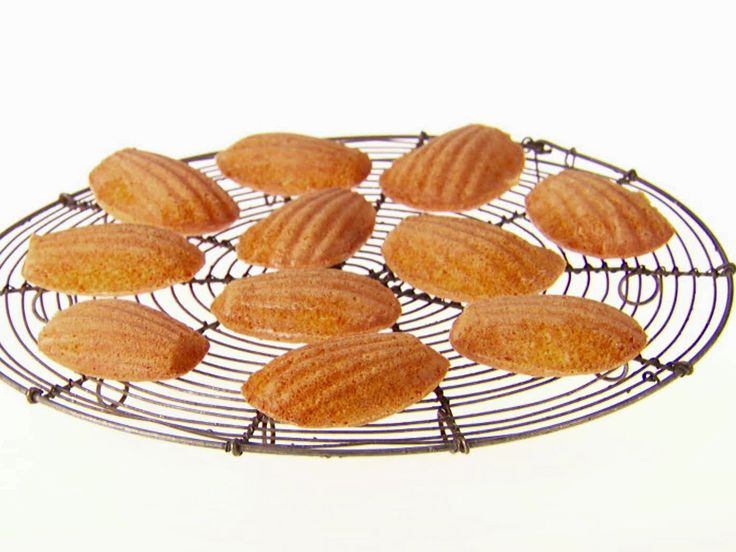 Honey-Almond Madeleines from Food Network.com  To make it not so sweet, swap the honey with sugar!