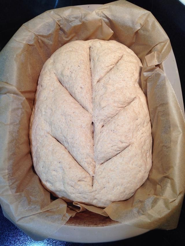 "Make slits in the dough , about 1/4"", to form a pattern. Place cover on Deep Covered Baker and let sit, covered for 15 minutes."