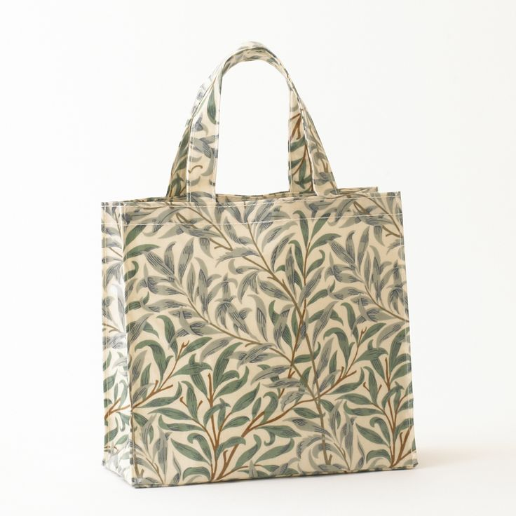 William Morris Willow Bough Pvc /Oilcloth Small Floral Tote Bag. This Licenced William Morris Willow Bough Blue Design was first designed in 1887. It was first produced as a wallpaper design which William's daughter, May Morris used to decorate her bedroom before being adapted for fabric in 1895 when it was block printed in Merton Abbey.