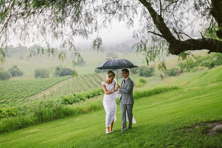 Wet weather wedding photo. Tallavera Grove Hunter Valley Image: Cavanagh Photography http://cavanaghphotography.com.au