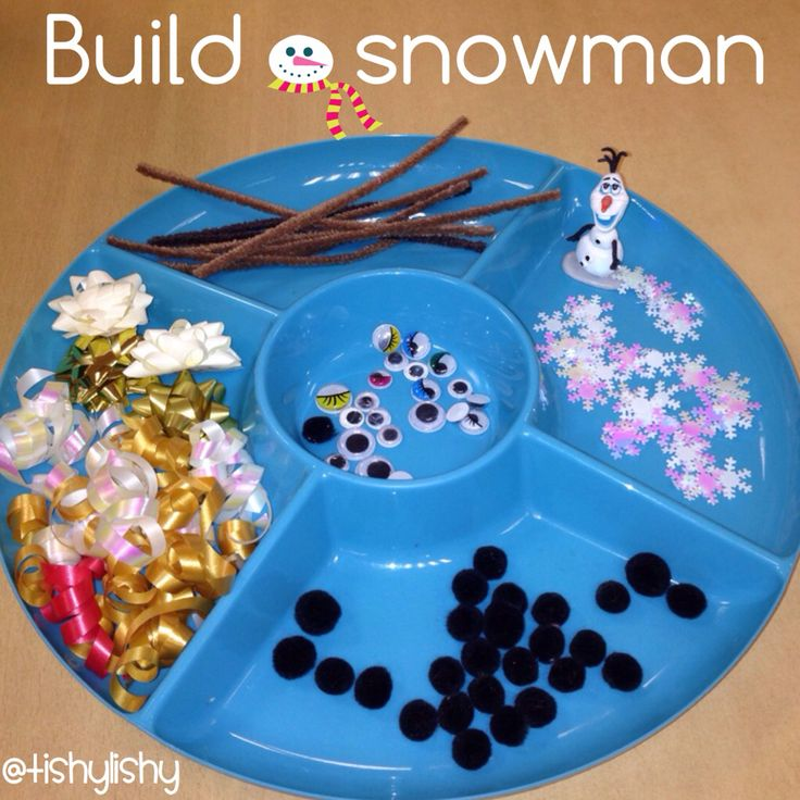 Build a snowman with white sparkly dough and enhancements