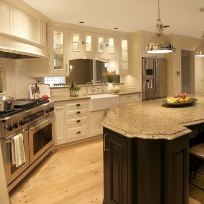 White Kitchen Cabinets W/dark Stained Island And Neutral Quartz Countertops