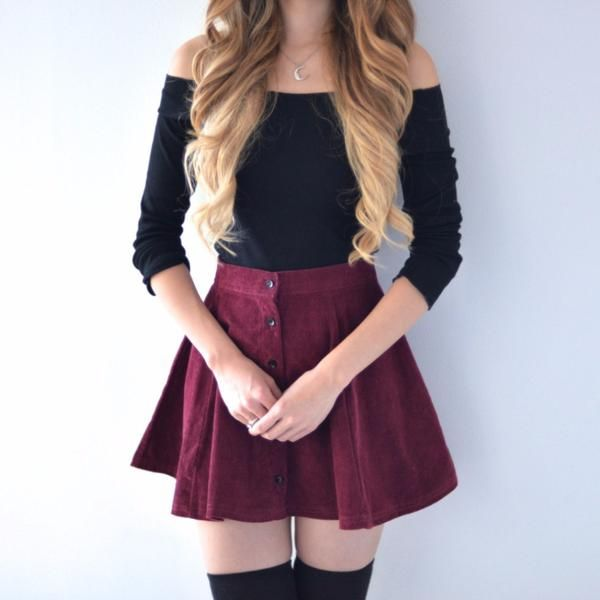 Our Instant best seller, the Lisa Button Skirt features a vertical row of buttons to accent the flareskirtline. Also available in Caramel! Model is pairing th