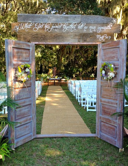 These rustic outdoor wedding doors were made by the bride and her family. She tells how they made them in the blog post. (The couple made a headboard from them after the wedding and now use them in the bedroom of their new home.)