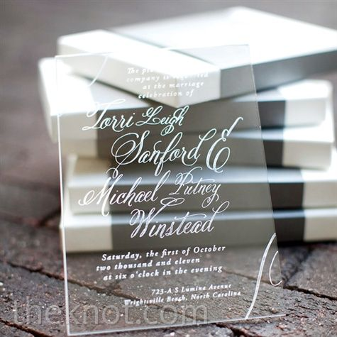 I have no idea how much these would cost but they look really cool!  Clear Acrylic Invitations