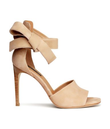 PREMIUM QUALITY. Suede sandals with a high heel back, wide strap that ties around the ankle, and leather linings, insoles and soles. Heel 11 cm.