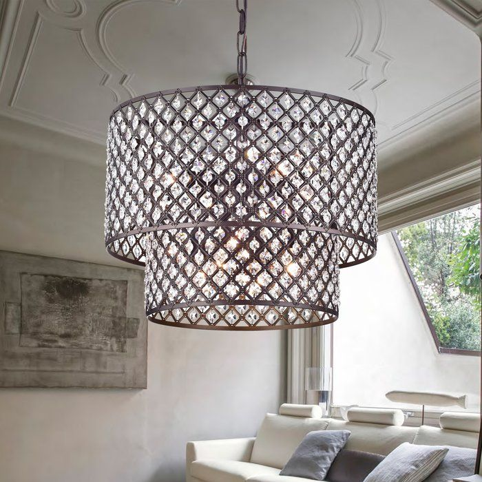 Bring this chandelier into your home for distinctive lighting that your friends and family admire. With hundreds of glass accents, it makes any room sparkle. The two barrel-shaped shades with their diamond-shaped portals encircle 8 bulbs providing up to 320 watts of warm, incandescent light. The fixture's flexible style works in retro-vintage settings as well as with eclectic and contemporary transitional decor.