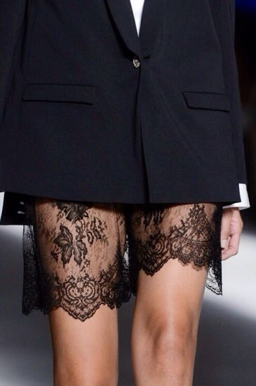 Ladylike and sultry - love the idea of peek-a-boo lace mixed with menswear.