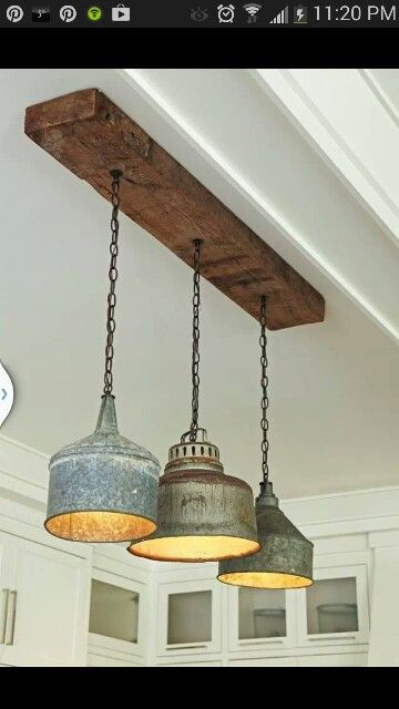 Rustic industrial lighting | I like the boarding the lights are on.  This will add the wood beams I wanted in the kitchen.