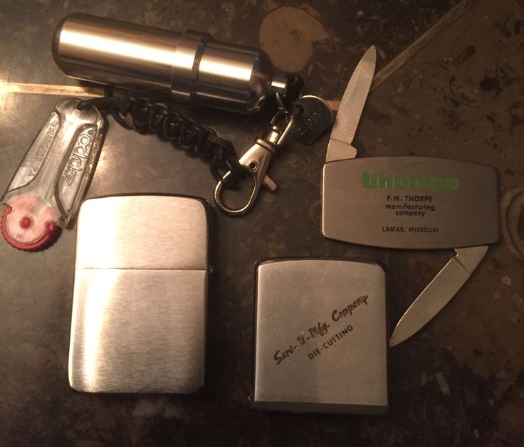 Zippo lighter, tape measure, pocket knife and lighter fluid refill canister with extra flint.