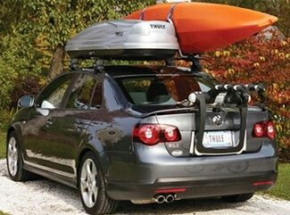 VW Jetta with roof rack, Thule cargo carrier, and bike rack.