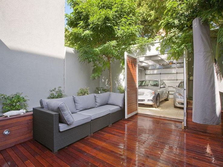 Indoor-outdoor outdoor living design with bbq area & decorative lighting using timber - Outdoor Living Photo 413131