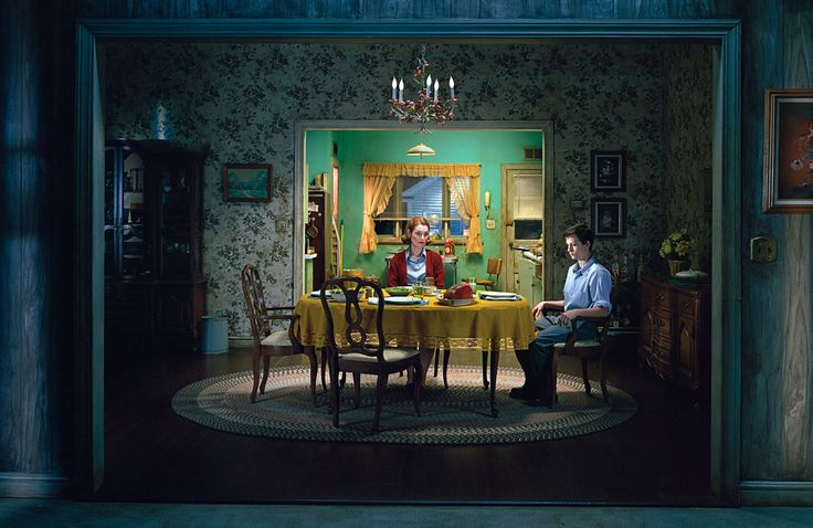 Gregory Crewdson's photographs usually take place in small town America, but are dramatic and cinematic. They feature often disturbing, surreal events. The photographs are shot using a large crew, and are elaborately staged and lit.