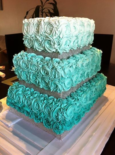 Ombre turquoise wedding cake with roses