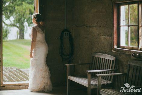 Erin waiting to move into the barn for the ceremony! Photo Credit: Fostered Photo #barnwedding #cambiumfarms #countrywedding #torontoweddingvenue #DIY #farm #caledon #rustic #barnceremony  #toronto #rainorshine