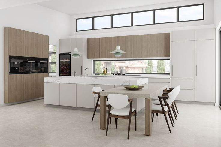 Open plan kitchen featuring thick marble island and tall timber joinery. Kangaroo Pt, NSW #DanKitchensAus