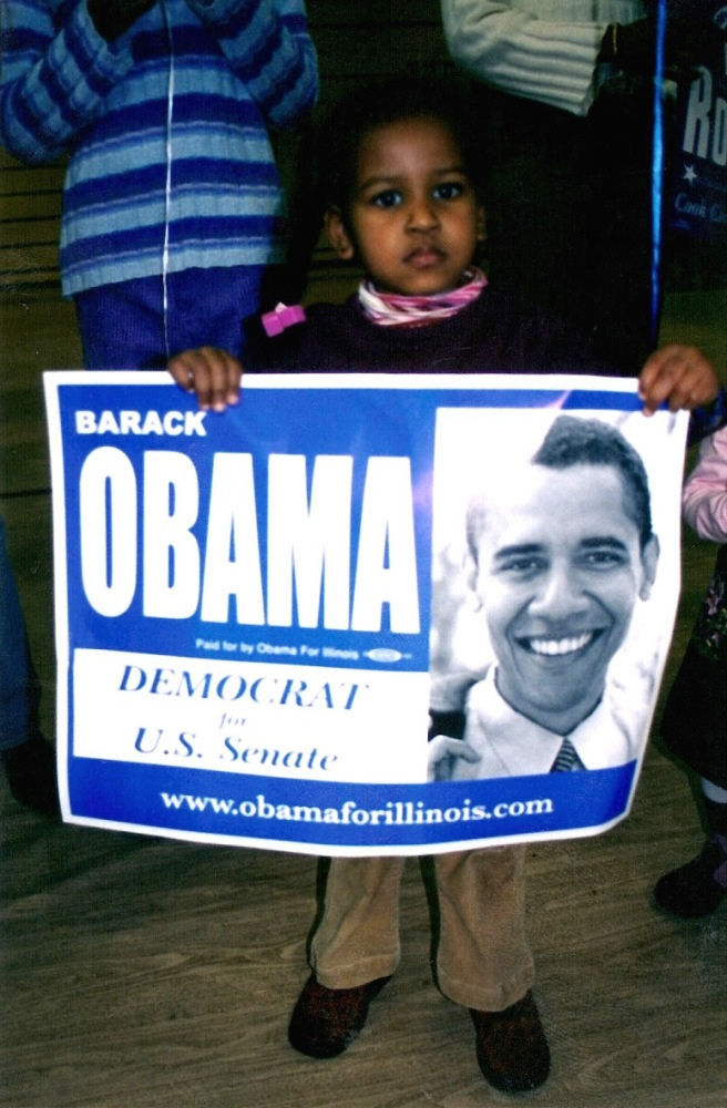Sasha Obama holds a campaign sign during her father's 2004 bid for the U.S. Senate.